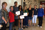 KHS top 3 winners pose with awards