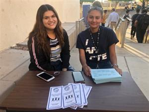 Students greeting guests at CTE Night