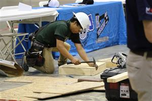 Kofa student hammering during a SkillsUSA competition