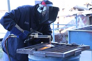 A student performing an OAC weld.