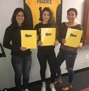 Three CHS softball players signed with Phoenix College on Nov. 10.