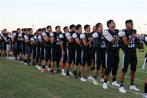 GRHS football lines up along side during anthem