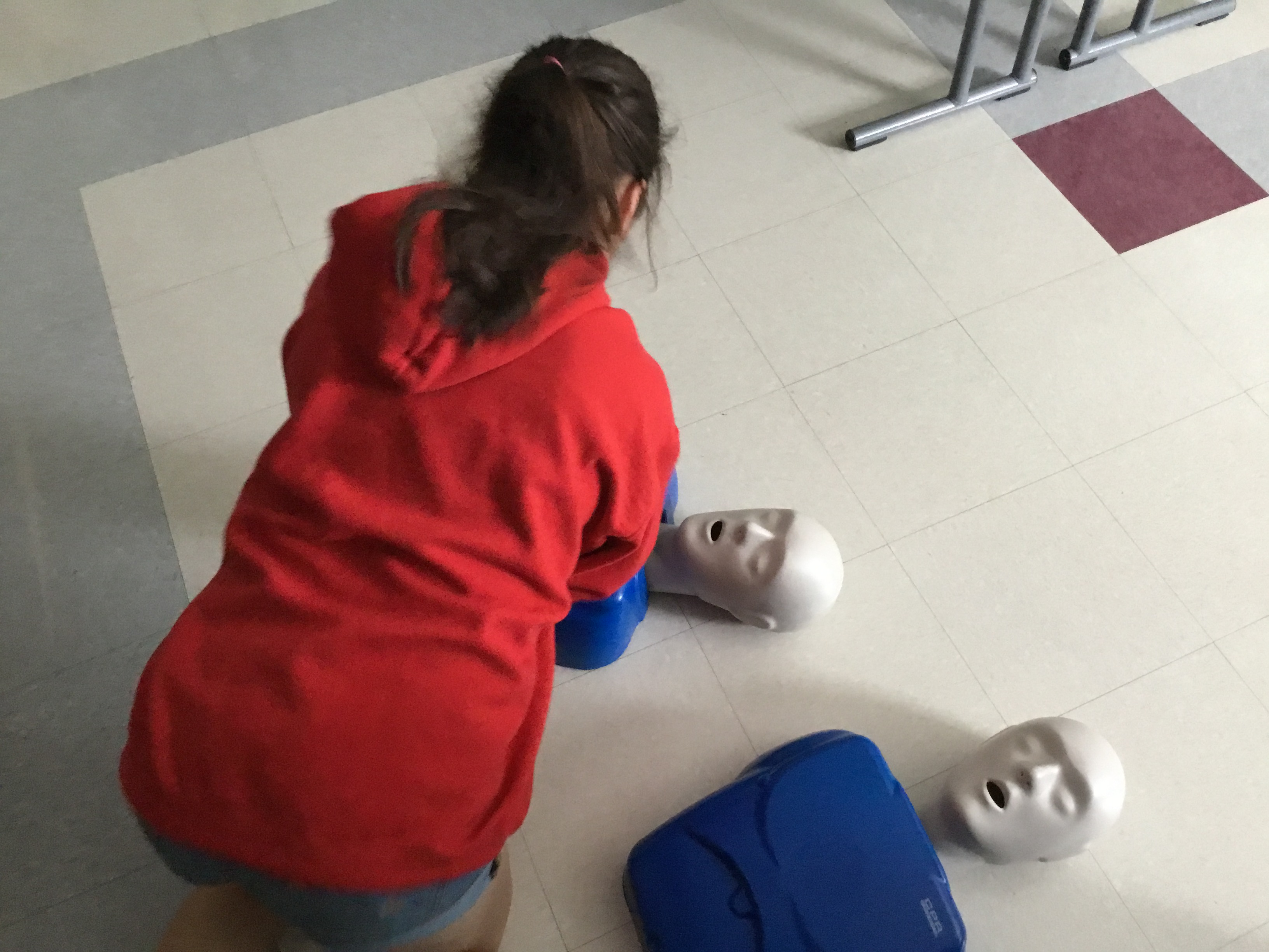 A student at the YUHSD Migrant Summer Academy demonstrates how to use CPR to save a life.