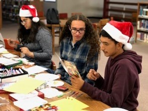Students creating Christmas cards for veterans