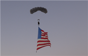 Jay Stokes skydiving with flag before 2018 game