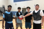 GRHS students hold ball on court
