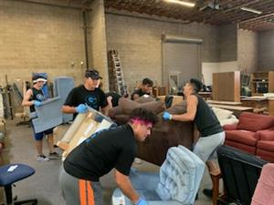 GRHS football helps at Crossroads Mission